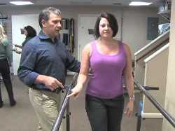 Berry AL physical therapist helping patient walk